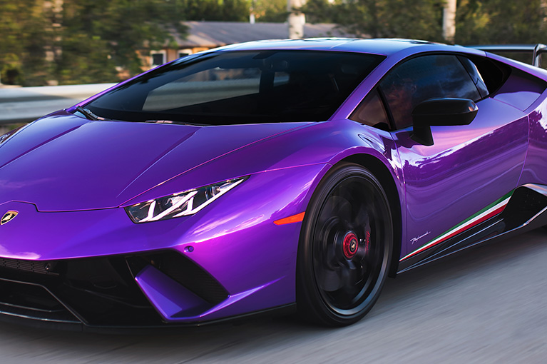 XPEL PRIME XR PLUS Automotive Window Tint on a purple Lamborghini